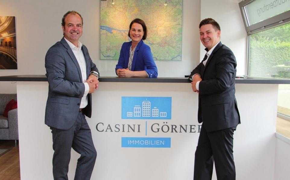 Enrico Casini mit Ehefrau Martina und Geschäftspartner Patrick Görner